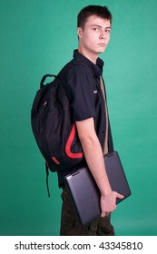 Student with laptop and backpack