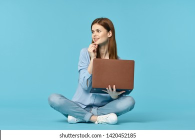 student with a laptop on a blue background