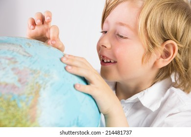 Student learning geography with globe on white background