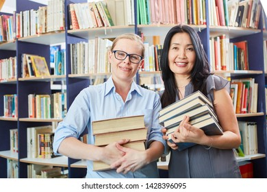 Student and librarian with books stack in the library or bookstore
