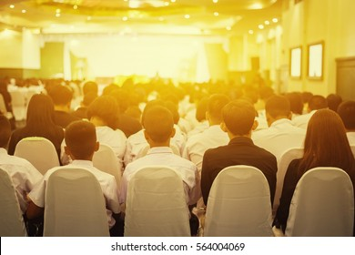 Student listening to Speaker Giving a Talk at Business Meeting marketing plan. Audience in the conference hall. Businessman and Entrepreneurship.unrecognizable people ,vintage color,selective focus