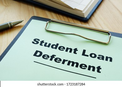 Student loan deferment application and clipboard.