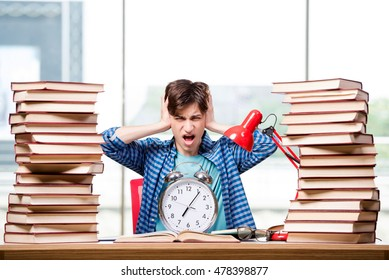 Student with lots of books preparing for exams