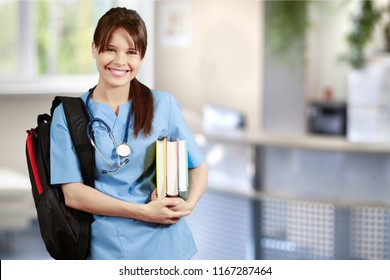 Student of medical school with backpack holding books