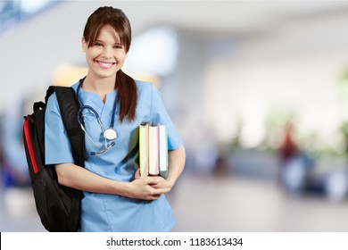 Student of medical school with backpack holding