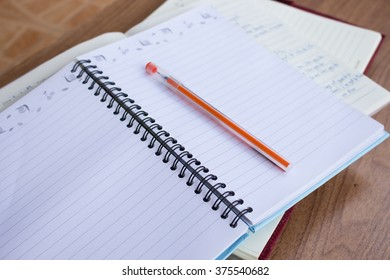 Student note book on wooden table, do homework