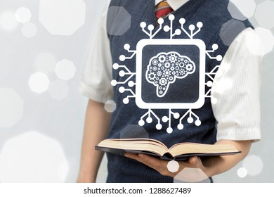 Student offers a book and micro processor with brain gears icon on a virtual screen. Learning Machine. Artificial Intelligence Education Technology. Academic Knowledge Library Digital Data Automation.