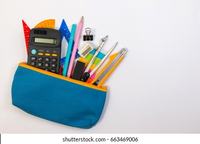 Student pencil bag or pencil case with school supplies for student on white background. Blue pencil box with school equipment for math class isolated on white background. School math equipment.