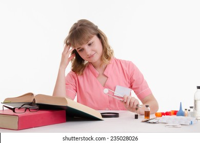 Student Pharmacist looking in the directory description tablets