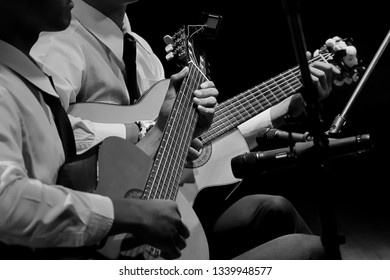 Student playing guitar Duo black and white