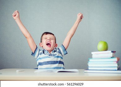 the student raised his hands for joy