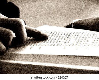 student reading the bible in black and white effect