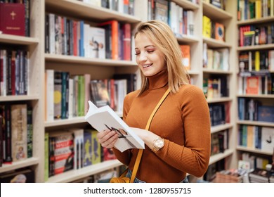 Student reading book in bookstore and leaning
