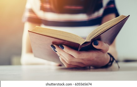 Student reading a book/Reading a book