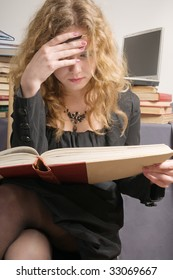 The student reads the old book.