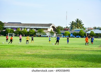 Student of Sangkha Wittayakom School playing football after school , on August 3, 2017 at football field in Sangkha District, Surin , Thailand.