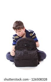 student with school bag on a white background