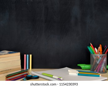 student school supplies and writing board behind