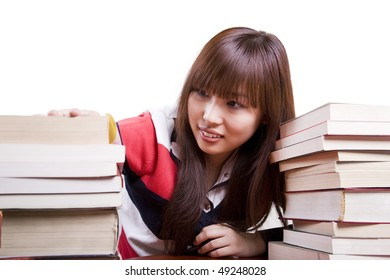 Student searching a book  from the stack of books on white background