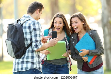 Student showing phone content to a friends outdoors in a park