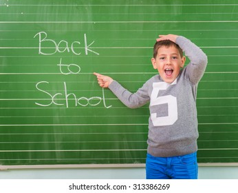 Student shows a board with the inscription: Back to School