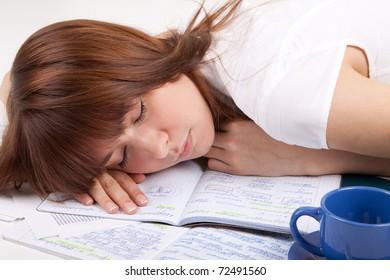 The student sleeps on writing-books