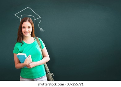 Student smiling at camera in library against teal