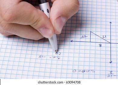Student solving a math problem using a pen.