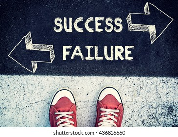Student standing above the sign for failure and success,dilemma concept