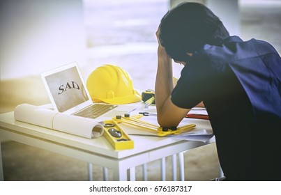 Student stressed design project at site construction worker.Sorry students Research, design, construction is unsuccessful.Vintage image.