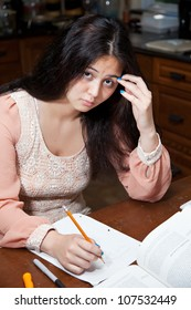 A student struggles with homework.