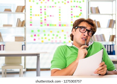 Student struggling at the exam in classroom
