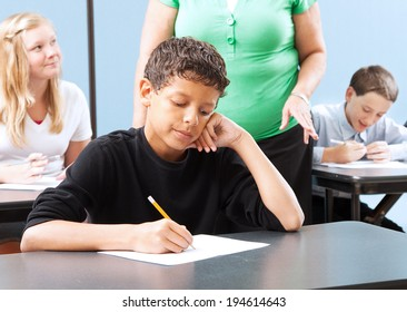 Student struggling with a standardized test in school.