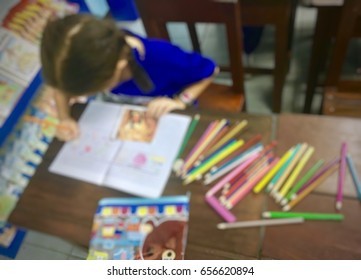 Student studying in the classroom : Lens blur