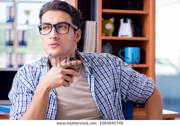 Student studying at home preparing for exam