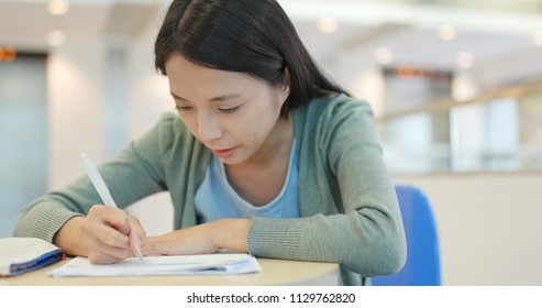 Student studying on her note at school
