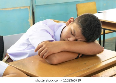 Student take a nap in classroom