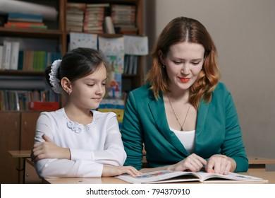 Student is tutoring an elementary school pupil school