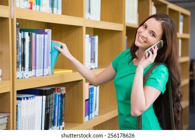 Student using her phone in library at the university