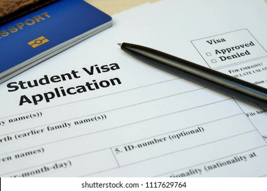 Student Visa application form with passport and pen. Document with passport, apply and permission for foreigner country