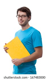 Student wearing the glasses holding a folder