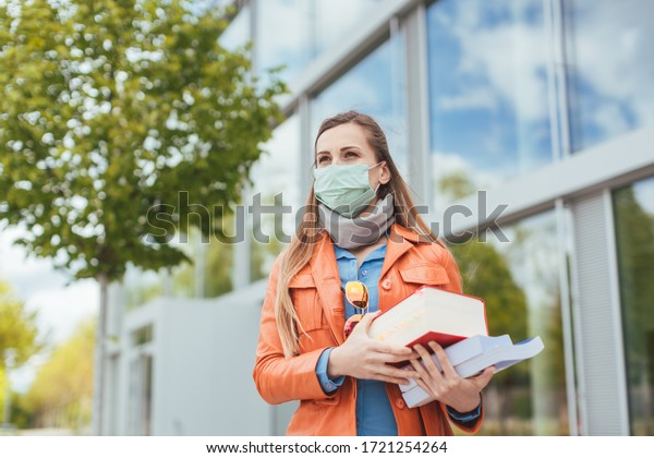 Student wearing mask during covid-19 cannot enter closed university building