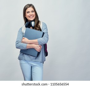 Student woman with backpack holding laptop. Isolated portrait.