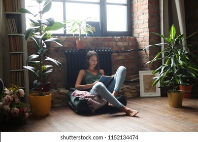 Student. Woman with book on the floor