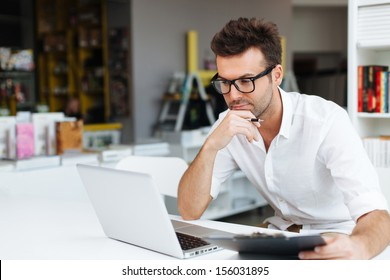 Student working on laptop in library