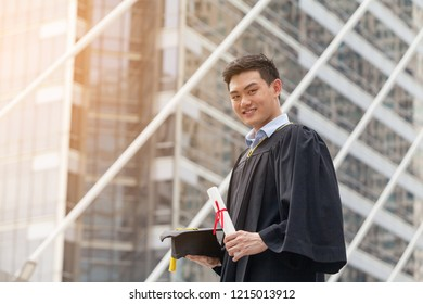 Student or Young Graduate Standing arms Crossed, holding a Degree With confidence There are views of the city as a backdrop. Ready to become a modern Business and move into the Labor market.