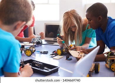 Students In After School Computer Coding Class Building And Learning To Program Robot Vehicle - Shutterstock ID 1404669740