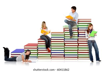 Students around a pile of books - isolated over a white background