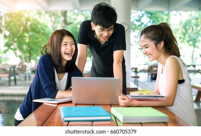 Students asian together group teenager studying smile with laptop computer, school folders reading book at university campus college knowledge center for study learning bright idea in summer holiday.