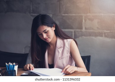 Students Asian woman reading a book for examination, Student,education and reading concept